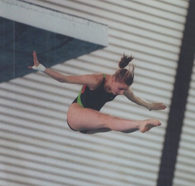 Hair-raising dive. With her hair tossed up in her descent; Anna Dacyshyn of the U of T puts together a good dive yesterday at Canadian senior winter diving championships at Etobicoke Olympium. She finished second.