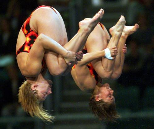 Canada's Emilie Heymans (left), from Greenfield Park, Que., and Anne Montminy, from Pointe Claire, Que., dive their way to a silver medal in the 10m platform syncronized diving event at the 2000 Summer Olympics in Sydney Australia Thursday Sept. 28, 2000. China won the gold.(CP PHOTO/Ryan Remiorz)