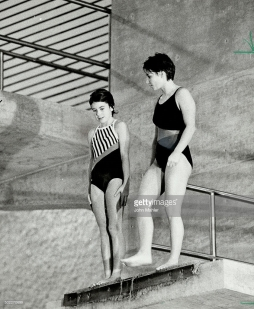 Tips from an Olympian. Olympic gold-medal diver Sylvie Bernier, doing the CTV show Thrill Of A Lifetime, gives some help yesterday to nervous-looking Sonja Bookman, 12, of Orangeville, who jumped off the 10-metre board at the Etobicoke Olympium.
